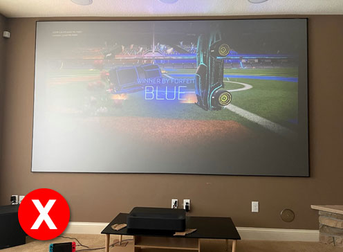 Image shows how a UST projector with CineGrey 3D looks like in a room with ambient light.