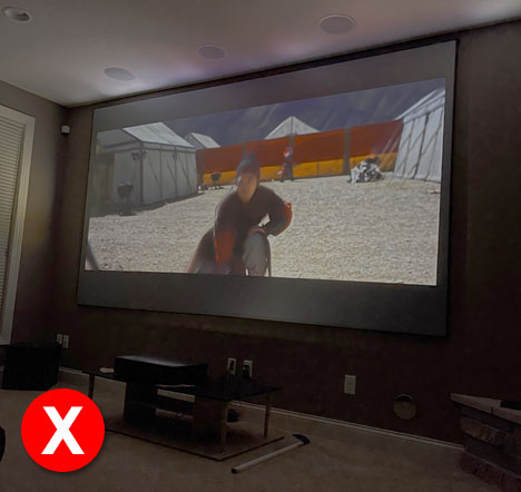 Image shows how a UST projector with CineGrey 3D® looks like in a room with lights turned off